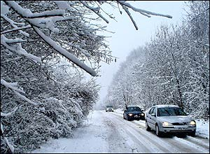 Cars struggling through snow in Chatham, Kent