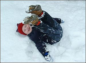 A young boy playing in the snow in Ashford, Kent