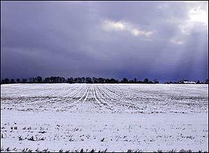 Cloud break over a snowy field near Glenrothes, Fife