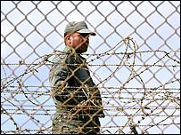 A soldier guards the border between Spain and Morocco