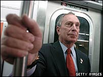 New York Mayor Michael Bloomberg rides the subway
