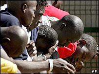 African immigrants wait at a holding station in the Spanish enclave of Melilla