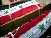 Iraqi flags drape coffins of Sunni Muslim men abducted and killed