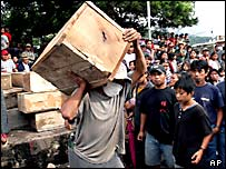 Villagers carry a coffin after a mudslide in Panabaj, Guatemala