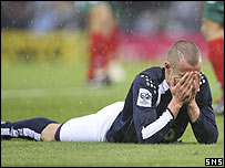 A dejected Kenny Miller