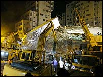 Cranes lift debris at site of Islamabad high-rise which collapsed