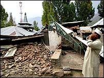 A Kashmiri Muslim calls for prayers outside a mosque in Uri, Indian-administered Kashmir