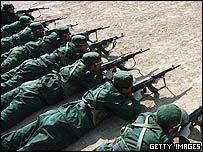 Recruits of the Chinese People's Liberation Army (PLA) take part in target practice at a training base on March 3, 2005 in Xining of Qinghai Province, China.