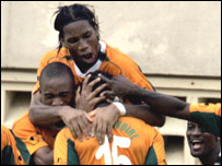 Didier Drogba celebrating with members of the Ivorian team