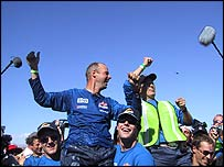 Sebastian Thrun celebrates his robot car crossing the finish line first at the Darpa Grand Challenge in Nevada
