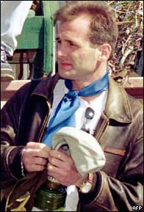 File picture of journalist Georgiy Gongadze seen here with a gas mask in his hands in Kiev in the summer 2000