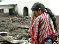 A woman mourns in Panabaj, Guatemala