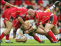 The Broncos (in red) get to grips with Leeds Rhinos' Andrew Dunemann