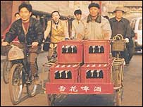 Chinese men transporting South African beer