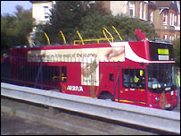 The bus with its roof ripped off