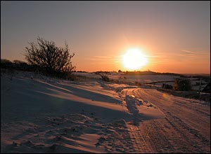 Sunrise over snow-covered fields