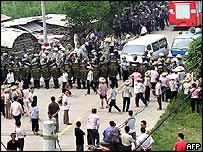 Chinese villagers face off with riot police in Taishi, Guangdong province, on 12 September 2005