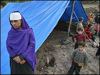 An injured woman stands outside her makeshift tent in Jabla, near Uri, India