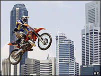 Dirt bike rider jumps in front of Singapore's financial district