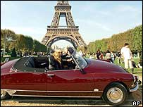 A Citroen 1968 DS Pallas convertible in front of the Eiffel Tower in Paris