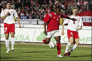 England striker Jermain Defoe races through the Poland defence for the first goal in a 2-1 win