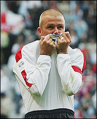David Beckham celebrates his goal at Old Trafford against Wales
