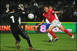 Michael Owen slots the only goal of the game against Azerbaijan
