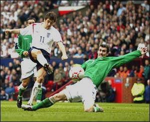 Joe Cole slots the opening goal of the game against Northern Ireland at home to set England on their way to a 4-0 win