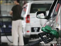 Malaysian driver fills up his car at a petrol station in Kuala Lumpur, Sunday, Sept. 11, 2005.