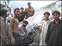 Zulfikar's relatives outside his family's destroyed house
