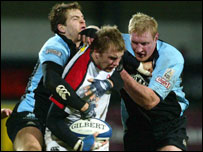Roger Wilson tries to set up an attack for Ulster