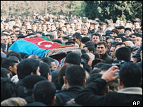 Crowds attend the funeral of Azeri journalist Elmar Huseynov