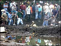 Volunteers dig for bodies in Panabaj, Guatemala