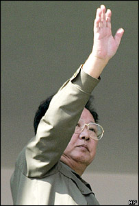 North Korean leader Kim Jong Il waves from the podium during the ceremony to mark the 60th founding anniversary of the ruling Workers' Party of Korea, in Pyongyang Monday, Oct. 10, 2005.