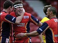 London Broncos's Luke Dorn celebrates a try against Warrington in February.