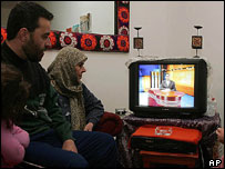 Beirut family watches news on Hezbollah's Al-Manar TV station