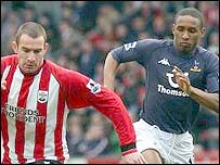 Saints Danny Higginbotham and Spurs Jermain Defoe