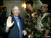 Ahmed Ben Helli, Arab League envoy to Iraq, salutes as he arrives at a hotel in Baghdad