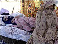 A mother and her injured daughter in a camp in Bagh, Pakistan-run Kashmir