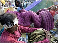 Injured Kashmiris and hundreds of others wait for medical aid in Muzaffarabad
