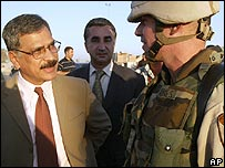 Iraqi Minister of Defence Hazem Shaalan greets a US army in Baghdad, July 2004