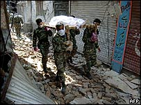 Pakistani troops carry body through Muzaffarabad street