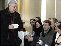 President Vladimir Voronin passes election observers as he casts his ballot in Moldova