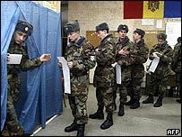 Soldiers queue to cast their vote in Chisinau, Moldova