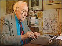 T Llew Jones at his typewriter