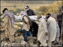People carry a burial in Bagh, three days after the earthquake hit the region