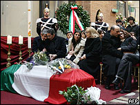 Relatives mourn beside Calipari's coffin, at Vittoriano Tomb of the Unknown Soldier monument in Rome