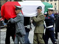 The coffin of agent Nicola Calipari is carried into the Vittoriano monument in central Rome