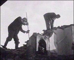 Men demolishing homes at Capel Celyn