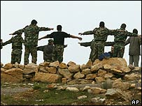 Syrian troops perform morning exercises on Mount Lebanon on Monday